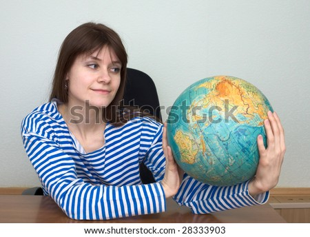 Woman in a stripped vest with terrestrial globe