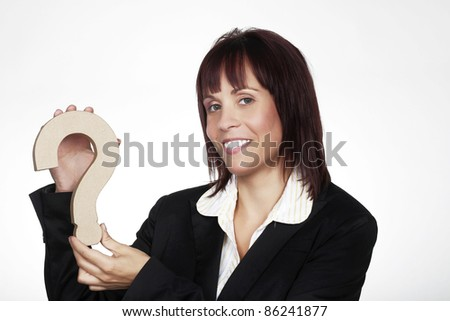 Woman in a suit holding up an question mark in her hands - stock photo