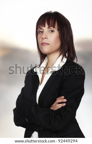 woman in a suit looking important at work - stock photo