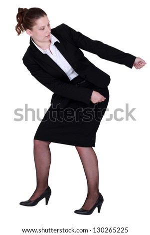 woman in a suit pulling something - stock photo