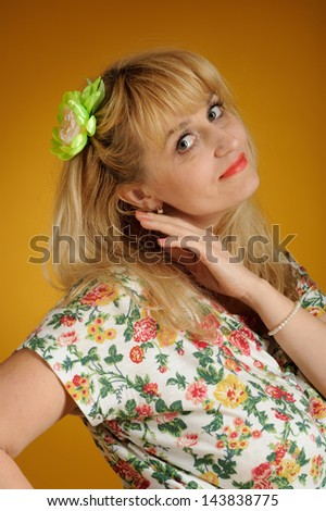 woman in a summer dress on a yellow background