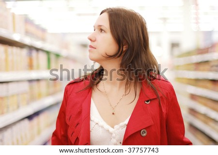 Woman in a super market - stock photo