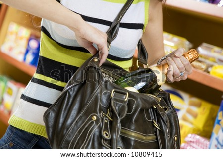 woman in a supermarket stealing a bottle of champagne