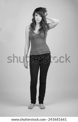 Woman in a tank top posing in black and white