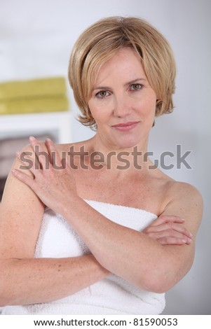 Woman in a towel - stock photo
