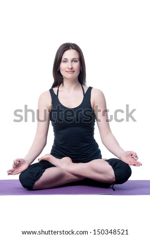 woman in a traditional yoga pose on white background