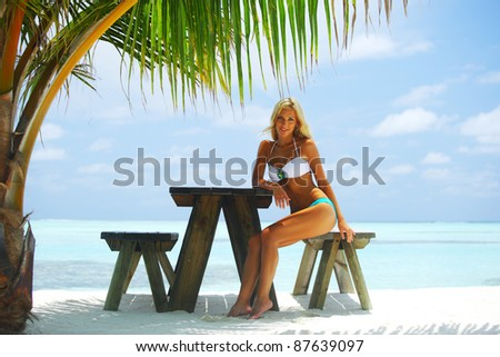 woman in a tropical cafe - stock photo