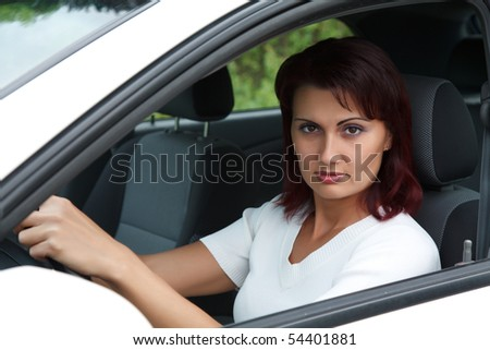Woman in a white car.