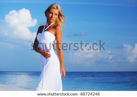 woman in a white dress on the ocean coast