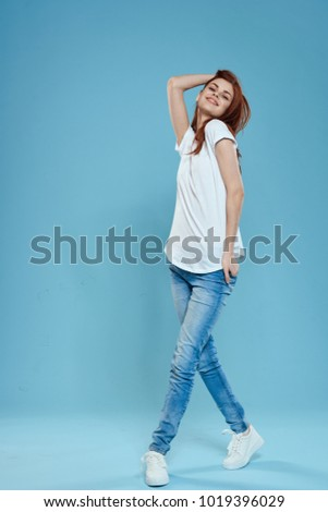 woman in a white T-shirt on a blue background