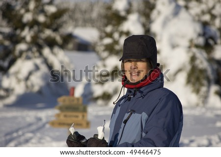 Woman in a winter landscape - stock photo