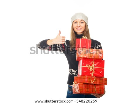 Woman in a winter sweater holding boxes with gifts. Beautiful girl on white background. Winter concept of advertising information. Christmas mood. Smiling woman with many gift boxes. New year concept