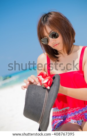 Woman in action on the beautiful beach at koh tachai