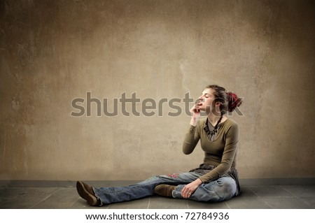 Woman in alternative clothes smoking a cigarette - stock photo