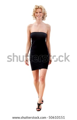 Woman in an elegant dress walking towards the camera - isolated over white - stock photo
