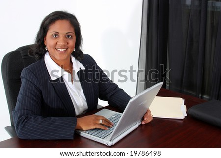 Woman in an office who is ready to work