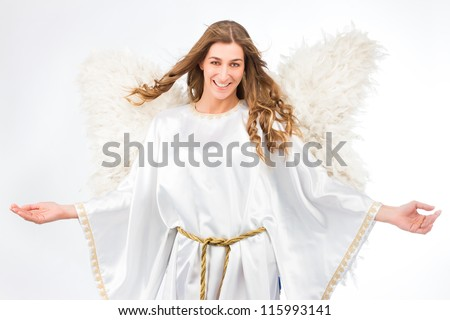 Woman in angel costume with artificial feather wings isolated on white background spirituality purity dreams religion - stock photo