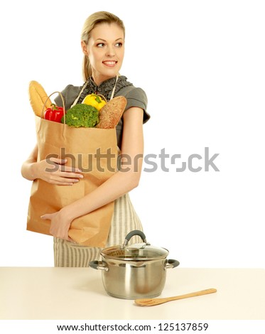 Woman in apron holding grocery bag , isolated on white background