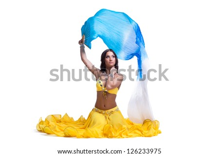 woman in arabic costume with flying veil isolated - stock photo