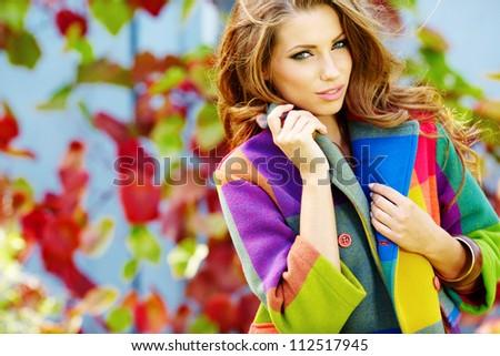 Woman in autumn park - stock photo