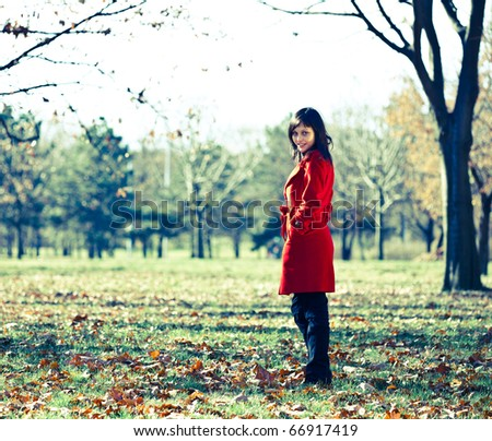Woman in autumn park, retro colors - stock photo