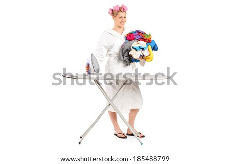Woman in bathrobe preparing clothes for ironing isolated on white background - stock photo