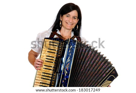 Woman in bavarian dirndl with accordion in front of a white background - stock photo