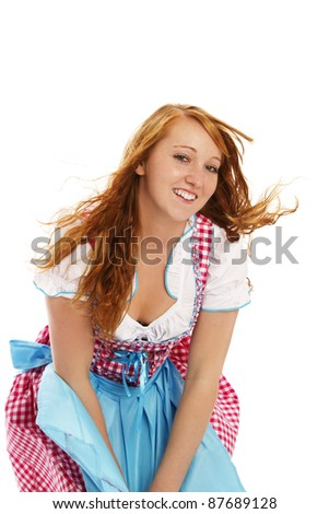 woman in bavarian dress handling with wind on white background - stock photo