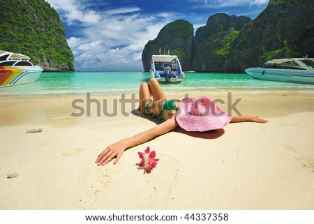 """Woman in beautiful lagoon at  Phi Phi Ley island, the exact place where """"The Beach"""" movie was filmed - stock photo"""