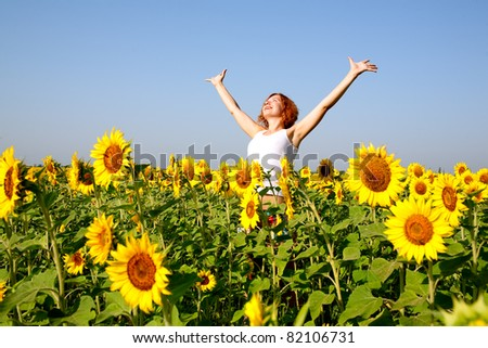 woman in beauty field with sunflowers - stock photo