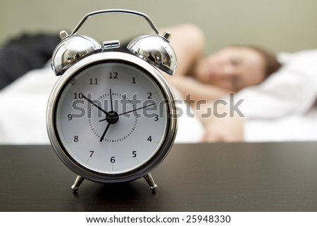 Woman in bed trying to wake up - stock photo