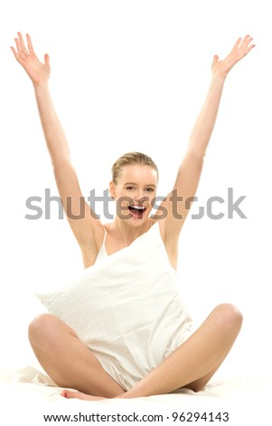 Woman in bed with arms raised - stock photo