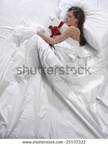 woman in bed with his present - stock photo