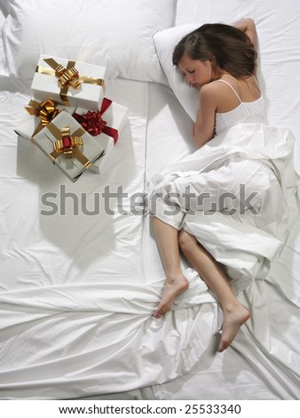 woman in bed with his presents - stock photo