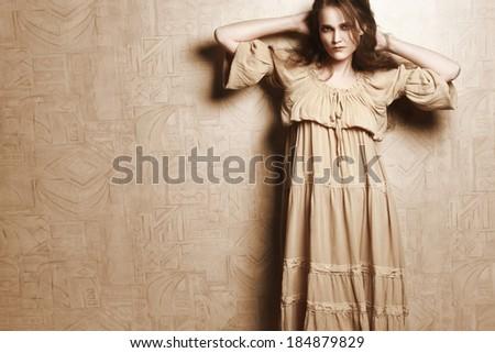 Woman in beige vintage dress. Young romantic model retro portrait - stock photo