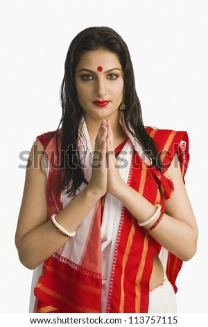 Woman in Bengali sari greeting - stock photo