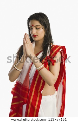 Woman in Bengali sari in prayer position - stock photo