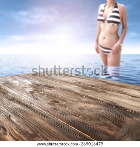 woman in bikini in blue water and top  - stock photo
