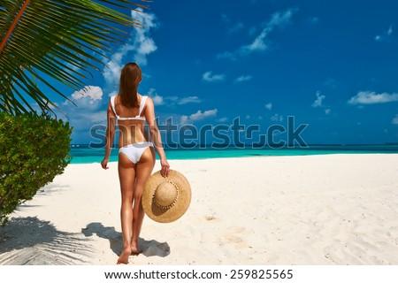 Woman in bikini on a tropical beach at Maldives - stock photo