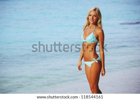 woman in bikini on sea beach