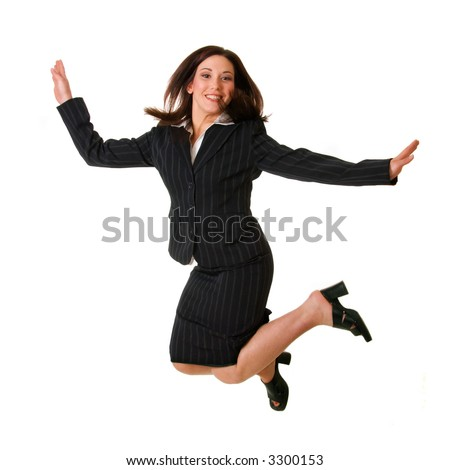 woman in black business suit jumps for joy; isolated on white background - stock photo