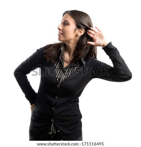 Woman in black clothes listening over white background