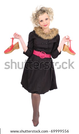 woman in black dress holding red shoes - stock photo