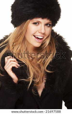 Woman in black fur hat and coat - on white background - stock photo