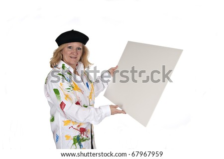 woman in black hat and painted shirt holding blank poster board on white background - stock photo