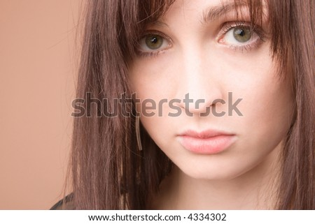 Woman in black isolated on beige background