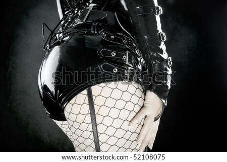 woman in black latex uniform - stock photo