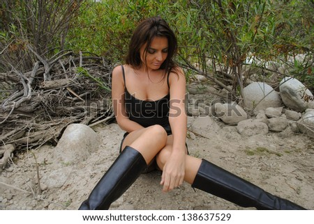 woman in black leather - stock photo