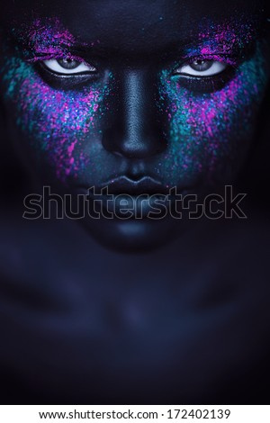 woman in black paint and pink powder - stock photo