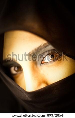 Woman in black scarf - stock photo